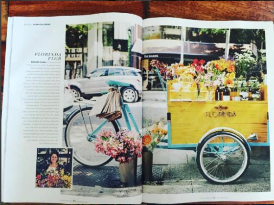 Florinda, um triciclo floricultura feito pelo Studio Vila ganha exposição em matéria de revista.